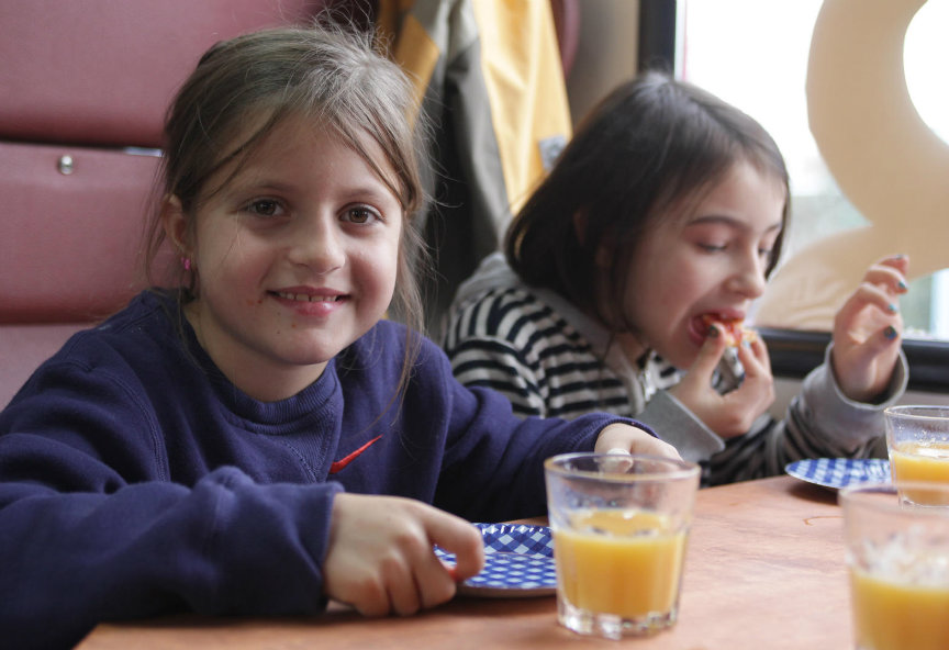 Kids eating in touring caravan
