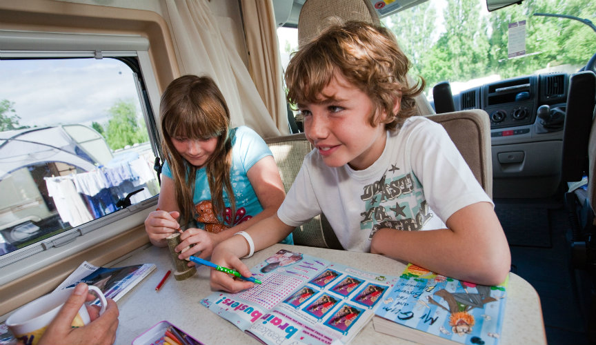 Kids playing games in motorhome